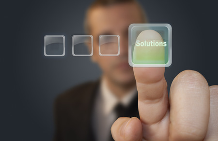Pressing solutions button photo