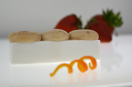 Presentation dessert, molecular spheres and Coconout flan. Stock Photo