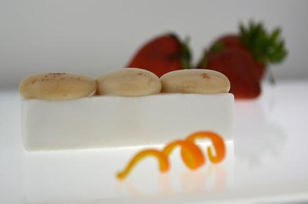 Presentation dessert, molecular spheres and Coconout flan. Stock Photo