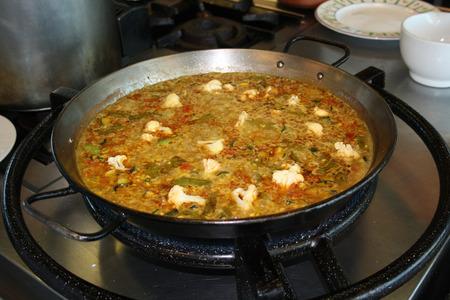 Cook making a paella