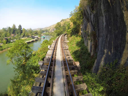 The railway between mountain and river Stock Photo