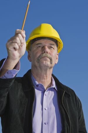 Architect pointing at building with pensil Stock Photo - 7136771