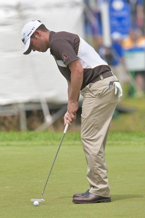 OAKVILLE, ONTARIO - JULY 22, 2009: William Chesney Reavie, known to the golf world as Chez, putts at a Pro-am event at the100th Canadian Open at Glen Abbey Golf Course on July 22, 2009 in Oakville, Ontario.