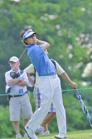 TORONTO, ONTARIO - JULY 21, 2010: Korean golfer Kevin Na follows his tee shot during a pro-am event at the RBC Canadian Open golf on July 21, 2010.
