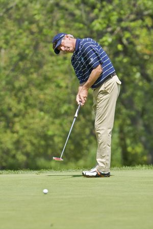 TORONTO, ONTARIO - JULY 21 : U.S. golfer Fred Couples putts  during a pro-am event at the RBC Canadian Open golf on July 21, 2010.