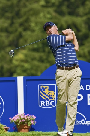 country club: TORONTO, ONTARIO - JULY 21, 2010 : U.S. golfer Fred Couples follows his tee shot during a pro-am event at the RBC Canadian Open,St. Georges; Golf and Country Club, Toronto, Ontario, July 21, 2010