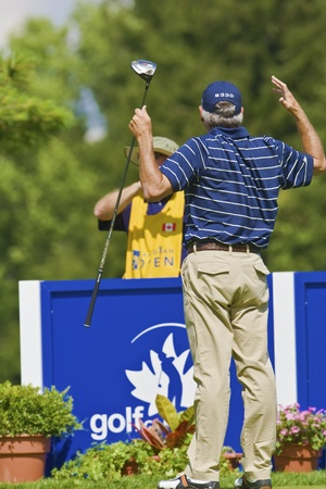 TORONTO, ONTARIO - JULY 21, 2010 : U.S. golfer Fred Couples after his tee shot during a pro-am event at the RBC Canadian Open,St. George's; Golf and Country Club, Toronto, Ontario, July 21, 2010