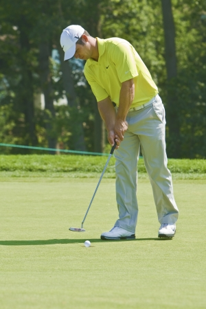 TORONTO, ONTARIO - JULY 21, 2010 : English golfer Paul Casey putts in during a pro-am event at the RBC Canadian Open golf on July 21, 2010.