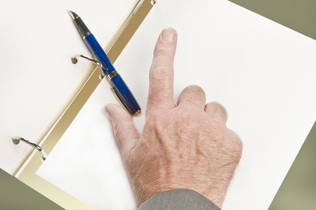 Businessman going through contract pages before to sign it. Focus on hand, pointing finger Stock Photo - 8916921
