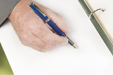 Businessman signing documents, contract. Focus on hand. Stock Photo - 8992725