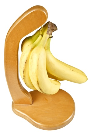 Ripe bananas hanging on special holder