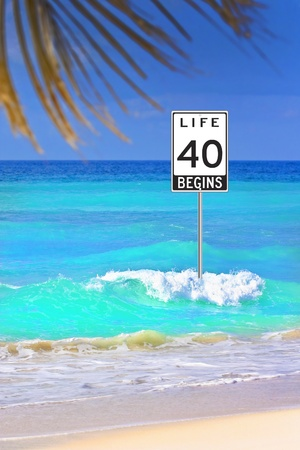 40: Life begins at 40. Road sign in the ocean as a optimistic warning.