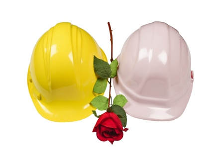 hard core: Man and Woman hard core hats with red rose. Isolated on white.