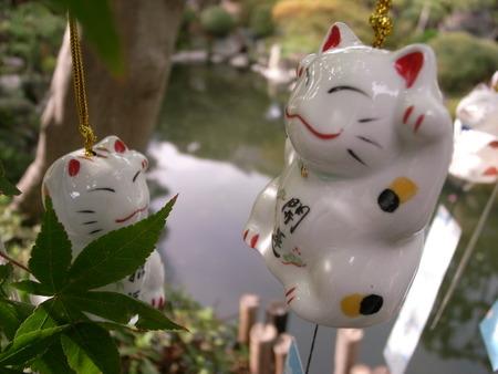 beckoning: Two beckoning cat. Stock Photo