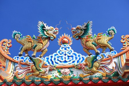 chinese style lion on the roof of chinese church photo