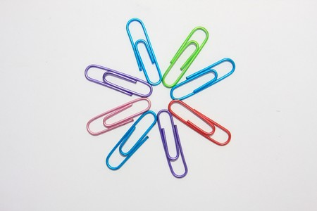 color paper clip in white background photo