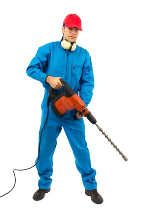 worker with protective gear holding a hammer drill on a white background photo