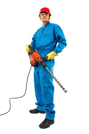 worker man on a white background wearing protective equipment holding a pneumatic drill