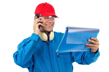 worker who looks at a project and talking on the phone Stock Photo - 15008309