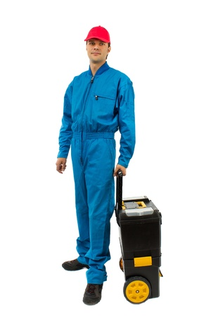 young worker wearing blue equipment tool box with wheels isolated on white Standard-Bild