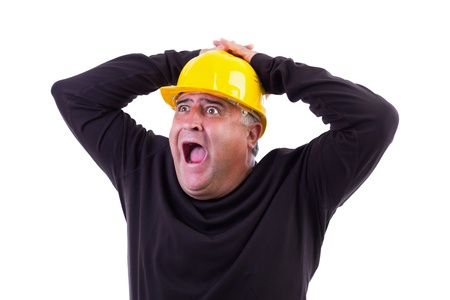 Worker screaming with hands on his  head, isolated on white Stock Photo - 15739778