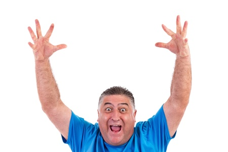 looking upwards: Happy man with his hands up  on white background Stock Photo