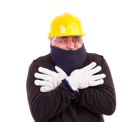 uncomfortable: Worker suffering cold with arms crossed isolated on white background