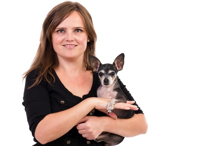 Portrait of a young woman holding her pet dog isolated on white background. photo