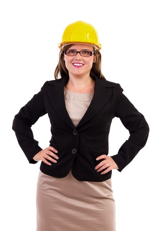 Young business woman wearing a hardhat. Safe business photo