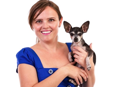 Portrait of a young woman holding her chihuahua dog isolated on white background. Stock Photo - 16008200