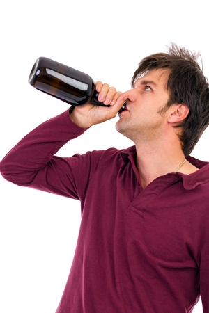 Young man drinking alcohol. Isolated on white Stock Photo - 16008207