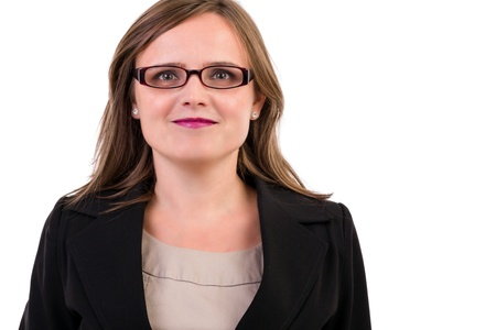 Portrait of a smiling young business woman wearing  glasses on white photo
