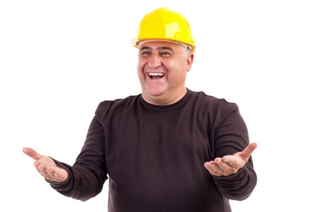 Happy construction worker with his arms outstretched isolated on white background