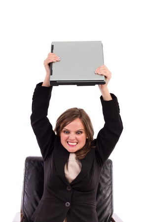 Angry businesswoman throwing her laptop on white Stock Photo