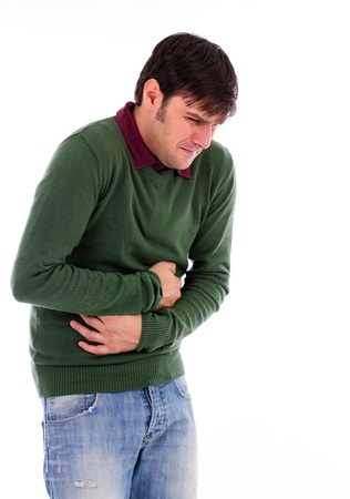 constipation symptom: Young man with strong stomach pain isolated on white background Stock Photo