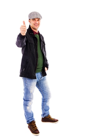 Happy young man smiling and showing thumb up, isolated on white background Stock Photo - 17324994