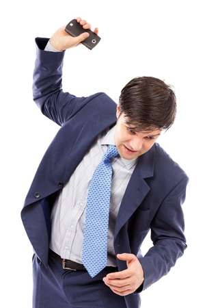 Angry businessman throwing  his mobile phone isolated on white background Stock Photo - 17680682