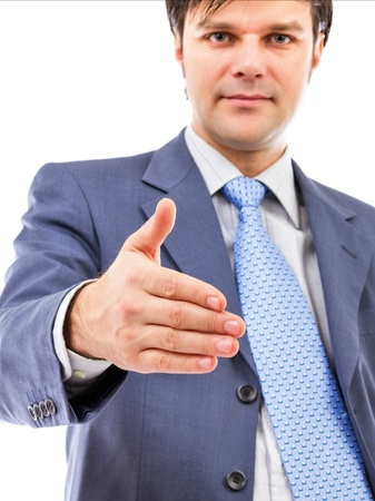 Young business man giving hand for handshake isolated on white background photo