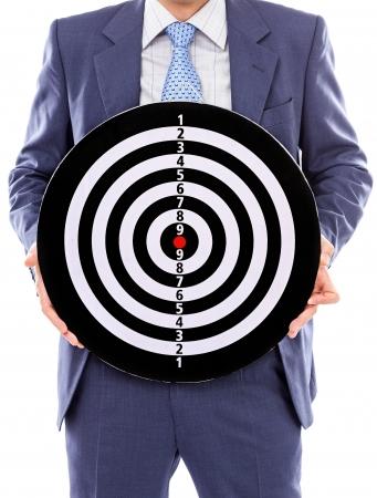 fling: Businessman holding a dartboard isolated on white background