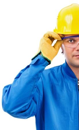 Junge Bauarbeiter mit Helm und Brille auf weißem Hintergrund Standard-Bild