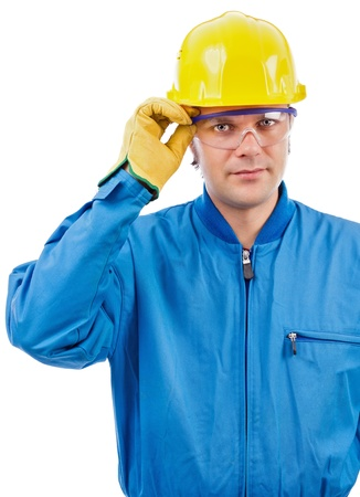 Young  construction worker with helmet and goggles on white background