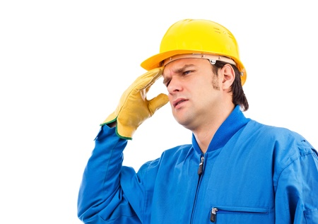 Young construction worker having a headache against white background Stock Photo - 18499364