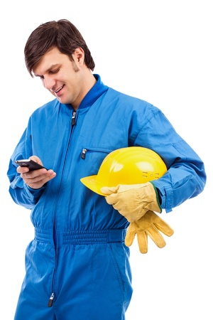 Portrait of a young worker using mobile phone isolated on white background photo