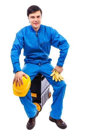 Young construction worker sitting on his toolbox isolated on white background Stock Photo - 18499336