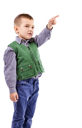 Portrait of a little boy pointing up isolated on white background photo