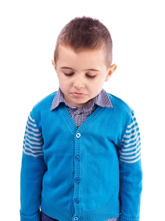 Close-up portrait of a sad little boy isolated on white background photo