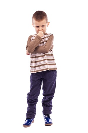 Portrait of a cute little boy thinking hard against white background