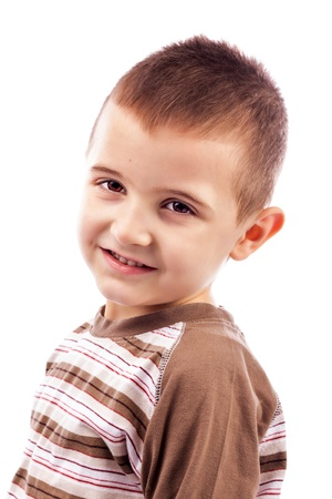Closeup portrait of a happy cute little boy isolated on white background photo