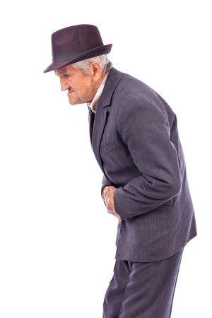 Old man with stomach pain against white background photo
