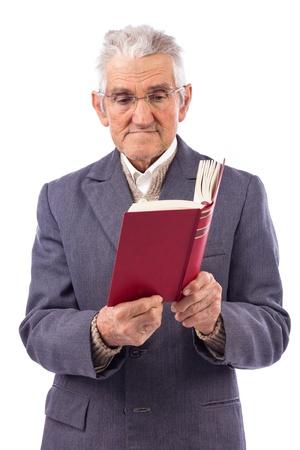 Portrait of an old man with glasses reading a book over white background photo
